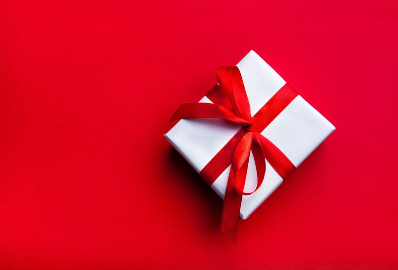gift with red bow on red background