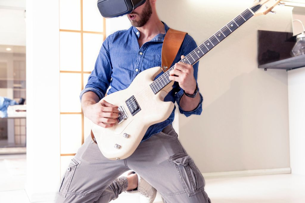 man playing guitar with oculus rift